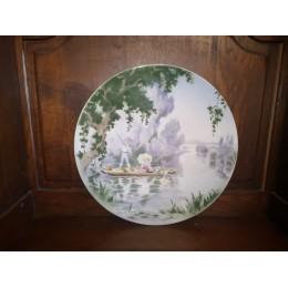 Plat circulaire signé Edmond Lachenal en faïence polychrome à décor d'1 élégante